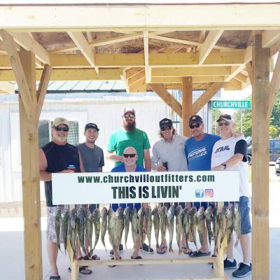 Charter guests with their catch of the day