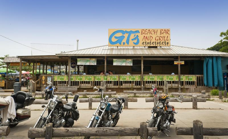 Motorcycles parked out front of GT's on the Beach