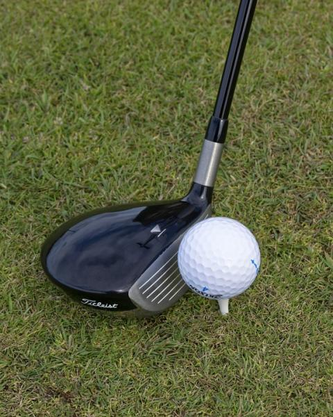 Close up driver and golf ball on tee